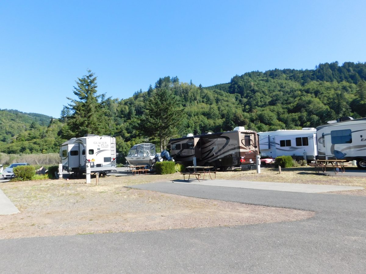RV Spaces at Hiking Trail at AtRivers Edge RV Resort in Brookings, Oregon